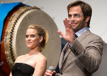 Us Actor Chris Pine (r) Waves to Fans Next to British Actress Alice Eve During a Photo Call Session at the Premiere of 'Star Trek Into Darkness' in Tokyo Japan 13 August 2013 the Action Adventure Sci-fi Film Directed by J J Abrams Will Hit Japanese Theaters on 23 August Japan Tokyo