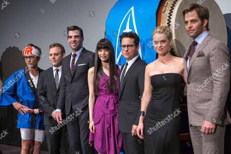 (l-r) Japanese Comedian Shingo Fujimori Us Producer Bryan Burk Us Actor Zachary Quinto Japanese Actress Chiaki Kuriyama Us Director J J Abrams British Actress Alice Eve and Us Actor Chris Pine Pose During a Photo Call For the Premiere of 'Star Trek Into Darkness' in Tokyo Japan 13 August 2013 the Action Adventure Sci-fi Film Directed by J J Abrams Will Hit Japanese Theaters on 23 August Japan Tokyo