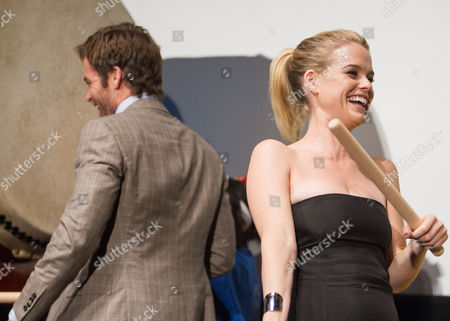 British Actress Alice Eve (r) Reacts As She Plays a Japanese Taiko Drum Along with Us Actor Chris Pine (l) During a Photo Call Session at the Premiere of 'Star Trek Into Darkness' in Tokyo Japan 13 August 2013 the Action Adventure Sci-fi Film Directed by J J Abrams Will Hit Japanese Theaters on 23 August Japan Tokyo