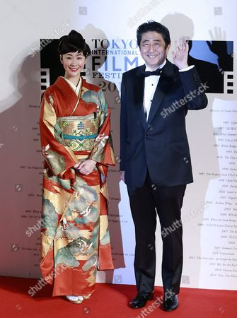Stock Photo of Japanese Prime Minister Shinzo Abe (r) and Japanese Actress Haru Kuroki (l) Arrive For the Opening of the 29th Tokyo International Film Festival (tiff) in Tokyo Japan 25 October 2016 the Tiff Will Show a Variety of Film Screenings Until 03 November Japan Tokyo