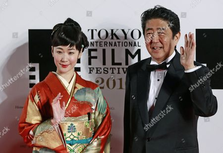 Japanese Prime Minister Shinzo Abe (r) and Japanese Actress Haru Kuroki (l) Arrive For the Opening of the 29th Tokyo International Film Festival (tiff) in Tokyo Japan 25 October 2016 the Tiff Will Show a Variety of Film Screenings Until 03 November Japan Tokyo
