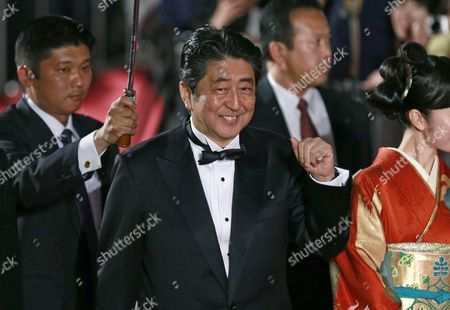 Stock Picture of Japanese Prime Minister Shinzo Abe (c) and Japanese Actress Haru Kuroki (r) Arrive For the Opening of the 29th Tokyo International Film Festival (tiff) in Tokyo Japan 25 October 2016 the Tiff Will Show a Variety of Film Screenings Until 03 November Japan Tokyo