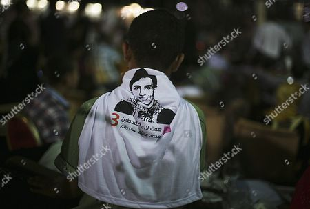 A Fan of Palestinian Singer Mohammad Assaf Wears on His Back a T-shirt Depicting the Singer As They Celebrate That Assaf Won the Arab Idol Talen Tv Show in North Gaza Strip Late 22 June 2013 Reports State That Since March 2013 Mohammad Assaf is Gaza's Powerful Voice Palestinians Watch Him Every Weekend in a Beirut-based Competition That Started out with 27 Contestants - Gaza Strip