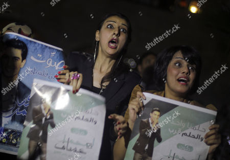 Fans Holding Posters of Palestinian Singer Mohammad Assaf React As They Attend an Event to Follow the Arab Idol Talent Tv Show in North Gaza Strip Late 22 June 2013 Palestinian Singer Mohammad Assaf Won the Contest Reports State That Since March 2013 Mohammad Assaf is Gaza's Powerful Voice Palestinians Watch Him Every Weekend in a Beirut-based Competition That Started out with 27 Contestants - Gaza Strip
