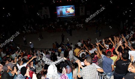 Fans of Palestinian Singer Mohammad Assaf Celebrate After He Won the Final of the Arab Idol Competition in Nablus West Bank 22 June 2013 Reports State That Since March 2013 the 22-year-old is Gaza's Powerful Voice Palestinians Watch Him Every Weekend in a Beirut-based Competition That Started out with 27 Contestants - Nablus