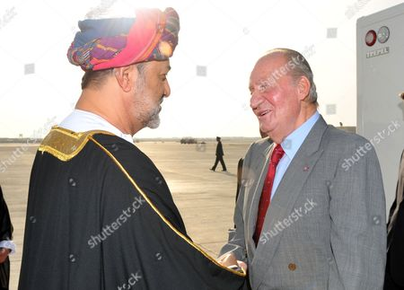 His Majesty Sultan Qaboos Bin Said Sultan of Oman (l) Welcomes Spanish King Juan Carlos at the Royal Airport in Muscat Oman 29 April 2014 As Part of His Official Visit to Middle East Oman Muscat