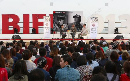 South Korean Directors Ryoo Seung-wan (l) and Kim Jee-woon (c) Attend the Open Talk 'Action Battle of the Directors: Kim Jee-woon and Ryoo Seung-wan' As Part of the 18th Busan International Film Festival (biff) at the Haeundae Biff Village in Busan South Korea 05 October 2013 the Biggest Film Festival in Asia Showcases 301 Films From 70 Countries From 03 to 12 October Korea, Republic of Busan