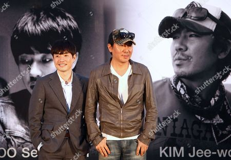 South Korean Directors Ryoo Seung-wan (l) and Kim Jee-woon (r) Pose During the Open Talk 'Action Battle of the Directors: Kim Jee-woon and Ryoo Seung-wan' As Part of the 18th Busan International Film Festival (biff) at the Haeundae Biff Village in Busan South Korea 05 October 2013 the Biggest Film Festival in Asia Showcases 301 Films From 70 Countries From 03 to 12 October Korea, Republic of Busan