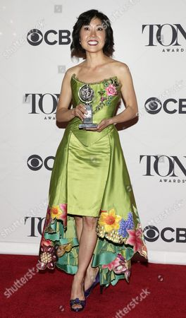 Costume Designer Linda Cho of the Us Holds the Tony Award For Best Costume Design of a Musical For Her Work in a Gentleman's Guide to Love & Murder in the Press Room at the 2014 Tony Awards at Radio City Music Hall in New York New York Usa 08 June 2014 the Annual Awards Honor Excellence in Broadway Theatre United States New York