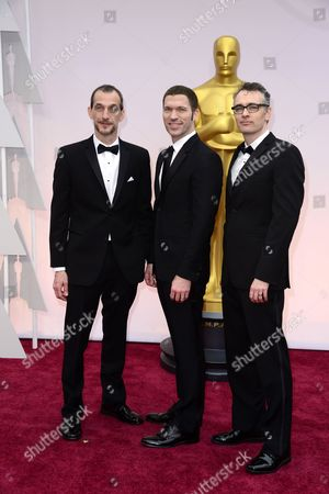 Anthony Stacchi (l) Graham Annable (r) and Travis Knight (c) Arrive For the 87th Annual Academy Awards Ceremony at the Dolby Theatre in Hollywood California Usa 22 February 2015 the Oscars Are Presented For Outstanding Individual Or Collective Efforts in 24 Categories in Filmmaking United States Hollywood