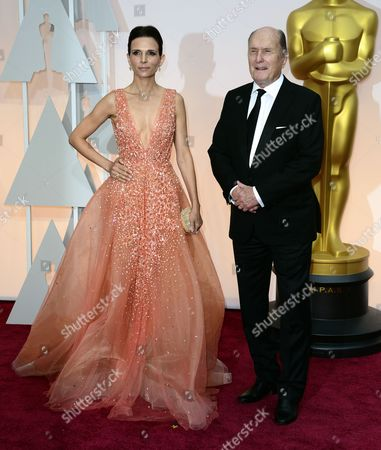 Actor Robert Duvall (r) and Luciana Pedraza (l) Arrive For the 87th Annual Academy Awards Ceremony at the Dolby Theatre in Hollywood California Usa 22 February 2015 the Oscars Are Presented For Outstanding Individual Or Collective Efforts in 24 Categories in Filmmaking United States Hollywood