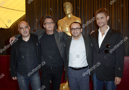 (l-r) Estonian Director Zaza Urushadze Polish Director Pawel Pawlikowski Russian Director Andrey Zvyagintsev and Argentinian Director Damian Szifron Pose For a Group Picture During the 87th Academy Awards Foreign Language Film Award Nominees Photo Op Presser on the Red Carpet Outside the Dolby Theatre in Hollywood California Usa 20 February 2015 Five Foreign Language Films Are Nominated For an Oscar United States Hollywood