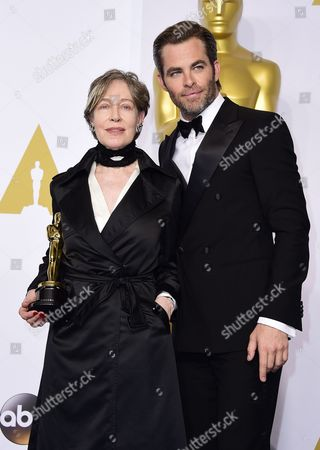 Milena Canonero (l) Poses Alongside Chris Pine (r) with Her Academy Award For Best Costume Design For 'The Grand Budapest Hotel' in the Press Room During the 87th Annual Academy Awards Ceremony at the Dolby Theatre in Hollywood California Usa 22 February 2015 the Oscars Are Presented For Outstanding Individual Or Collective Efforts in 24 Categories in Filmmaking United States Hollywood