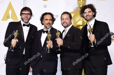 (l-r) Nicolas Giacobone Alejandro G Inarritu Alexander Dinelaris Jr and Armando Bo with Their Academy Awards For Best Original Screenplay For 'Birdman Or (the Unexpected Virtue of Ignorance' in the Press Room During the 87th Annual Academy Awards Ceremony at the Dolby Theatre in Hollywood California Usa 22 February 2015 the Oscars Are Presented For Outstanding Individual Or Collective Efforts in 24 Categories in Filmmaking United States Hollywood