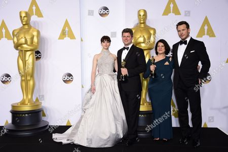 Adam Stockhausen (2-l) and Anna Pinnock (2-r) with Their Academy Award For Production Design For 'The Grand Budapest Hotel' Pose with Presenters Felicity Jones (l) and Chris Pratt (r) in the Press Room During the 87th Annual Academy Awards Ceremony at the Dolby Theatre in Hollywood California Usa 22 February 2015 the Oscars Are Presented For Outstanding Individual Or Collective Efforts in 24 Categories in Filmmaking United States Hollywood