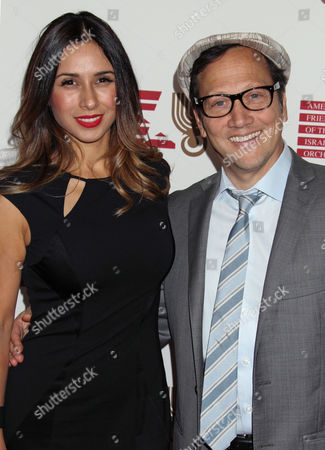 Stock Image of Us Producer Patricia Azarcoya Schneider and Us Actor Rob Schneider Arrive For the American Friends of the Israel Philharmonic Orchestra Benefit at the Wallis Annenberg Center For the Performing Arts in Beverly Hills California Usa 16 July 2014 the American Friends of the Israel Philharmonic Orchestra Honored German Composer Hans Zimmer with a Lifetime Achievement Award United States Beverly Hills