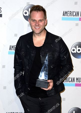Us Singer Matthew West Poses For Photographs with His Favorite Artist Contemporary Inspirational Award in the Press Room at the 2013 American Music Awards at the Nokia Theatre in Los Angeles California Usa 24 November 2013 United States Los Angeles