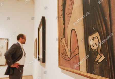 Michael Rooks Curator of Modern and Contemporary Art Looks at Works by Cuba-born Artist Wilfredo Lam at the Exhibition 'Imagining New Worlds: Wifredo Lam Jose Parla Fahamu Pecou' at the High Museum of Art in Atlanta Georgia Usa 23 February 2015 the Exhibit is a Retrospective of the Twentieth-century Cuban Artist Wifredo Lam and Responses to Lam's Work by Contemporary Artists Jose Parla and Fahamu Pecou the Exhibition Runs Through 24 May 2015 United States Atlanta