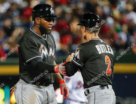 Miami Marlins Center Fielder Marcell Ozuna (l) is Greeted by Miami Marlins Third Base Coach Brett Butler (r) Against the Atlanta Braves in the Sixth Inning of Their Mlb Baseball Game at Turner Field in Atlanta Georgia Usa 29 August 2014 United States Atlanta