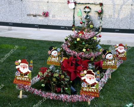 christmas theme decorations adorn a grave at the inglewood park cemetery in inglewood california usa 28