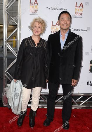 Us Actor and Cast Member Steve Park (r) and Wife Us Actor Kelly Coffield Park (l) Arrive For the Us Premiere of 'Snowpiercer' in Los Angeles California Usa 11 June 2014 United States Los Angeles