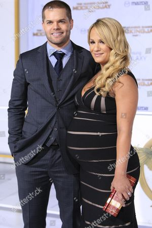 Us Actor and Cast Member Wes Chatham (l) Arrives with Wife Us Tv Personality Jenn Brown (r) For the Premiere of 'The Hunger Games: Mockingjay - Part 1' at the Nokia Theatre L a Live in Los Angeles California Usa 17 November 2014 the Movie Opens in Us Theaters on 21 November United States Los Angeles