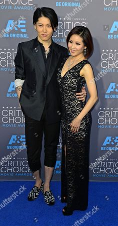 Japanese Singer Miyavi (l) and Us-japanese Singer Melody Ishihara (r) Arrive For the 20th Annual Critics' Choice Awards in Hollywood California Usa 15 January 2015 United States Hollywood