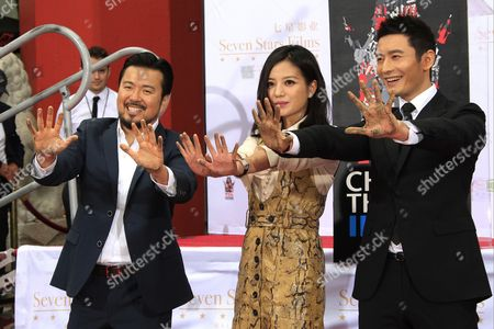 (l-r) Us Director Justin Lin Chinese Actress Zhao Wei and Chinese Actor Huang Xiaoming at the 88th Birthday of Tcl Chinese Theater Imax and Hand and Footprint Ceremony For Justin Lin Zhao Wei and Huang Xiaoming at Tcl Chinese Theater in Hollywood California Usa 03 June 2015 United States Hollywood