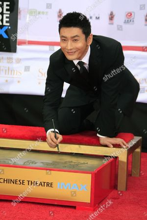 Chinese Actor Huang Xiaoming at the 88th Birthday of Tcl Chinese Theater Imax and Hand and Footprint Ceremony For Justin Lin Zhao Wei and Huang Xiaoming at Tcl Chinese Theater in Hollywood California Usa 03 June 2015 United States Hollywood