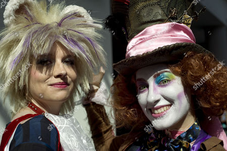Kit Leitmeyer 28 (l) From San Diego and Brianna Garcia 30 From Anaheim California Pose For Photographs on the Opening Day of Comic-con 2014 in San Diego California Usa 24 July 2014 Leitmeyer is Dressed As the Character Dormouse and Garcia As the Mad Hatter United States San Diego
