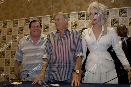 Original Actors in the 1960s Television Series Batman Pose For Photographers at a Press Conference During Comic-con 2014 in San Diego California Usa on 24 July 2014 L-r Are Burt Ward (portrayed Robin) Adam West (portrayed Batman) and Julie Newmar (portrayed Catwoman ) United States San Diego