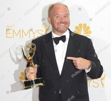 Stock Photo of Louis C K Winner of the Emmy For Outstanding Writing For a Comedy Series For 'Louie ' Poses in the Press Room During the 66th Annual Primetime Emmy Awards Held at the Nokia Theatre in Los Angeles California Usa 25 August 2014 the Primetime Emmy Awards Celebrate Excellence in National Primetime Television Programming United States Los Angeles