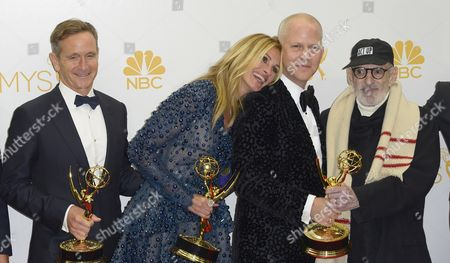 (l-r) Dante Di Loreto Julia Roberts Ryan Murphy and Larry Kramer Winners of the Emmy For Outstanding Television Movie For 'The Normal Heart ' Poses in the Press Room During the 66th Annual Primetime Emmy Awards Held at the Nokia Theatre in Los Angeles California Usa 25 August 2014 the Primetime Emmy Awards Celebrate Excellence in National Primetime Television Programming United States Los Angeles