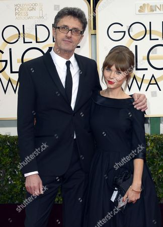 Polish Director Pawel Pawilikowski (l) and Polish Actress Agata Trzebuchowska (r) Arrive For the 72nd Annual Golden Globe Awards at the Beverly Hilton Hotel in Beverly Hills California Usa 11 January 2015 United States Beverly Hills