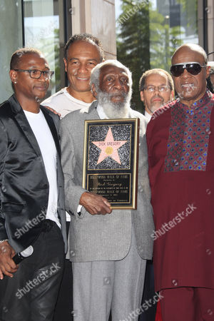 Us Entertainer/activist Dick Gregory (c) with Guests (l-r) Tommy Davidson Ray Parker Jr Stevie Wonder Poses with His Star on the Hollywood Walk of Fame During Ceremony in Hollywood California Usa 02 February 2015 Gregory was Awarded the 2 542nd Star on the Hollywood Walk of Fame in the Category of Live Theatre/performance United States Hollywood