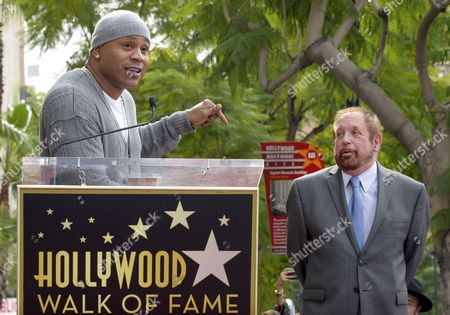 Us Singer Ll Cool J (l) Introduces Us Television Producer Ken Ehrlich (r) During Ehrlich's Star Ceremony on the Hollywood Walk of Fame in Hollywood California Usa 28 January 2015 Ehrlich was Awarded the 2 541st Star on the Hollywood Walk of Fame in the Category of Television United States Hollywood