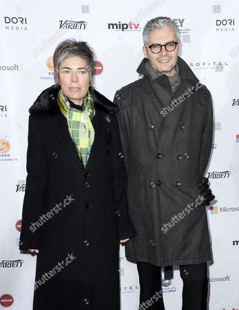 Stock Photo of Caroline Benjo Producer and Jimmy Desmarais Producer of the French Drama Series 'Les Revenants' (the Returned) Arrive For the 41st International Emmy Awards Gala Held at the Hilton Hotel in New York New York Usa 25 November 2013 United States New York