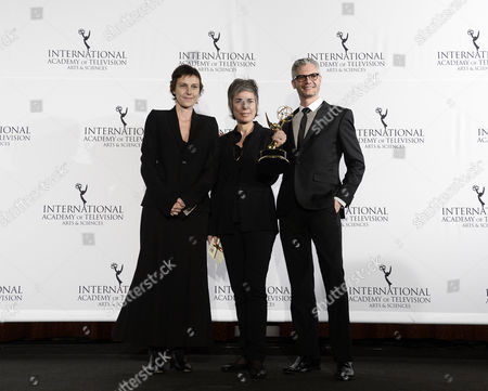 Stock Picture of (l-r) Producers Carole Scotta Caroline Benjo and Jimmy Desmarais Hold Up Their Award For a Drama Series During the 41st International Emmy Awards Gala at a Hotel in New York New York Usa 25 November 2013 United States New York