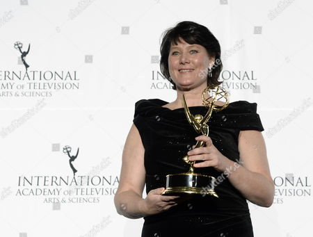 Stock Picture of German Anke Schaferkordt Co-ceo of Rtl Group Holds Her International Emmy Directorate Award During the 41st International Emmy Awards Gala at a Hotel in New York New York Usa 25 November 2013 United States New York