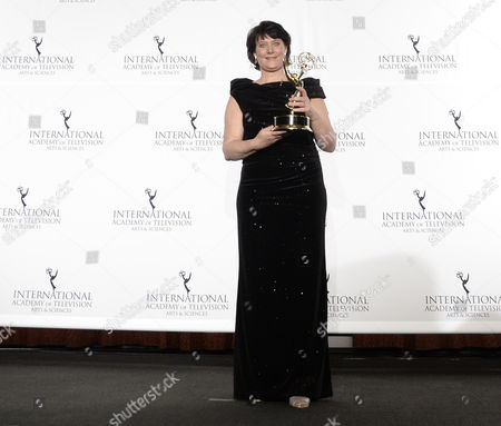 Stock Image of German Anke Schaferkordt Co-ceo of Rtl Group Holds Her International Emmy Directorate Award During the 41st International Emmy Awards Gala at a Hotel in New York New York Usa 25 November 2013 United States New York