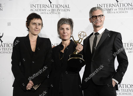 Stock Image of (l-r) Producers Carole Scotta Caroline Benjo and Jimmy Desmarais Hold Up Their Award For a Drama Series During the 41st International Emmy Awards Gala at a Hotel in New York New York Usa 25 November 2013 United States New York