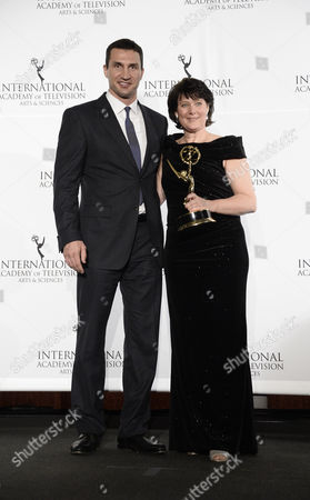 Stock Photo of Ukrainian Heavyweight Professional Boxer Wladimir Klitschko (l) Poses with German Anke Schaferkordt Co-ceo of Rtl Group Holding Her Directorate Award During the 41st International Emmy Awards Gala at a Hotel in New York New York Usa 25 November 2013 United States New York