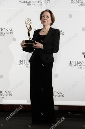 Brazilian Actress Fernanda Montenegro Holds Her Award For 'Best Performance by an Actress' For 'Sweet Mother' During the 41st International Emmy Awards Gala at a Hotel in New York New York Usa 25 November 2013 United States New York