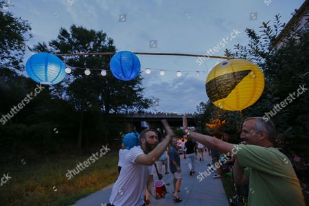 Jeff Cohen (r) is Congratulated by a Passerby on His Pac-man Inspired Creation During the Atlanta Beltline Lantern Parade in Atlanta Georgia Usa 04 September 2014 Participants Create Their Own Led-illuminated Lanterns and Walk More Than Two Miles Down the Eastside Trail of the Atlanta Beltline to Celebrate the Opening of a New Year of Art Along the Pedestrian Byway United States Atlanta