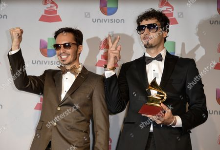 Argentinian Musicians Dante Spinetta (r) and Emmanuel Horvilleur (l) Hold Their Award For Best Urban Song For 'Ula Ula' in the Press Room During the 14th Annual Latin Grammy Awards Ceremony at the Mandalay Bay Resort and Casino in Las Vegas Nevada Usa 21 November 2013 United States Las Vegas