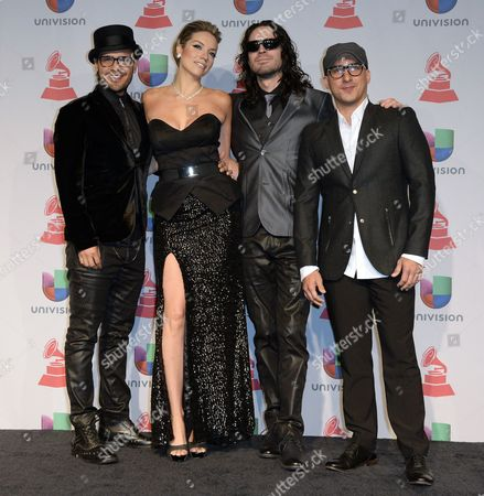 Stock Picture of (l-r) Members of Argentinian Group Mojito Lite Juan Manuel Medina Laura Mayolo Juan Pablo Renteria and Dayhan Diaz Pose in the Press Room During the 14th Annual Latin Grammy Awards Ceremony at the Mandalay Bay Resort and Casino in Las Vegas Nevada Usa 21 November 2013 United States Las Vegas