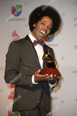 Cuban-canadian Singer Alex Cuba Holds His Award For Best Short Form Music Video in the Press Room During the 14th Annual Latin Grammy Awards Ceremony at the Mandalay Bay Resort and Casino in Las Vegas Nevada Usa 21 November 2013 United States Las Vegas