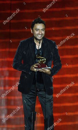 Colombian Singer Alex Campos Holds His Award For Best Christian Album (spanish Language) For 'Regreso a Ti' Onstage During the 14th Annual Latin Grammy Awards Ceremony at the Mandalay Bay Resort and Casino in Las Vegas Nevada Usa 21 November 2013 United States Las Vegas