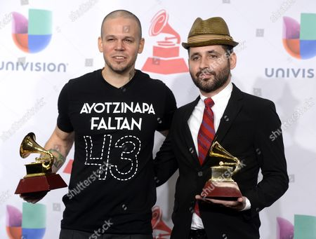 Members of the of Puerto Rican Band Calle 13 Rene Perez Joglar (l) Wearing a T-shirt Reading '43 Missing Ayotzinapa' in Reference to the Missing Students in Mexico and Eduardo Cabra Martinez (r) Hold the Latin Grammys For Best Alternative Song and Best Urban Music Album at the 15th Annual Latin Grammy Awards at the Mgm Grand in Las Vegas Nevada Usa 20 November 2014 Latin Grammy Awards Recognize Artistic And/or Technical Achievement not Sales Figures Or Chart Positions and the Winners Are Determined by the Votes of Their Peers-the Qualified Voting Members of the Academy United States Las Vegas