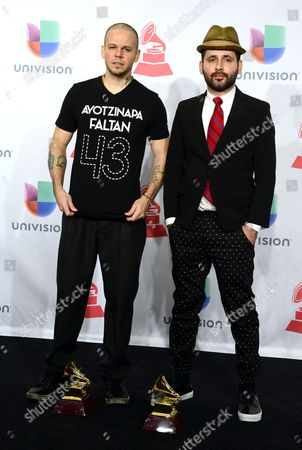 Members of the of Puerto Rican Band Calle 13 Rene Perez Joglar (l) Wearing a T-shirt Reading '43 Missing Ayotzinapa' in Reference to the Missing Students in Mexico and Eduardo Cabra Martinez (r) Pose with Their Latin Grammys For Best Alternative Song and Best Urban Music Album at the 15th Annual Latin Grammy Awards at the Mgm Grand in Las Vegas Nevada Usa 20 November 2014 Latin Grammy Awards Recognize Artistic And/or Technical Achievement not Sales Figures Or Chart Positions and the Winners Are Determined by the Votes of Their Peers-the Qualified Voting Members of the Academy United States Las Vegas